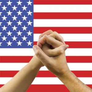 a woman and a man in his hands with a flag of USA background in concept of unity